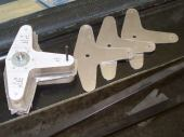 On 7 March, I made the leaves for the T-shaped inboard flaperon bellcrank. Needing four identical leaves, I made a pair of particle board templates, a stack of aluminum rough blanks, and then milled the blanks to the template outline using a router with a carbide bit. The HummelBird builders swear by that technique for making wing rib blanks, and I can see why. Chalk one up for See'n'saw.