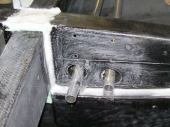 The left wing root rib, showing the push-pull tube exits and the mounting holes for the auto-connect bellcrank brackets.
